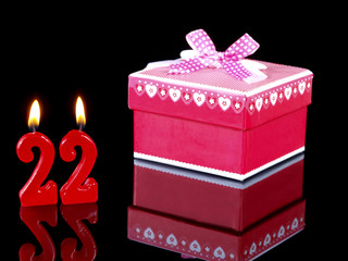 Birthday  gift with red candles showing Nr. 22
