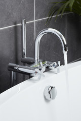 Bath tap in contemporary bathroom