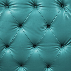 Close up cyan luxury buttoned black leather