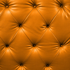 Close up orange luxury buttoned black leather