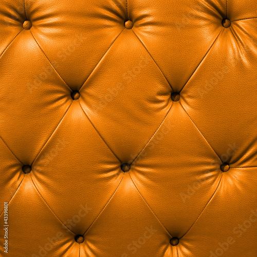 Staande foto Leder Close up orange luxury buttoned black leather