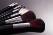 make-up brushes on grey background