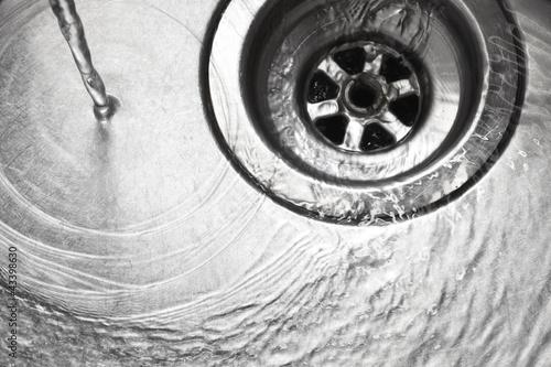 Leinwandbild Motiv Stainless steel sink plug hole
