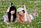 Two pleasant ladies have a rest on a floral lawn poster