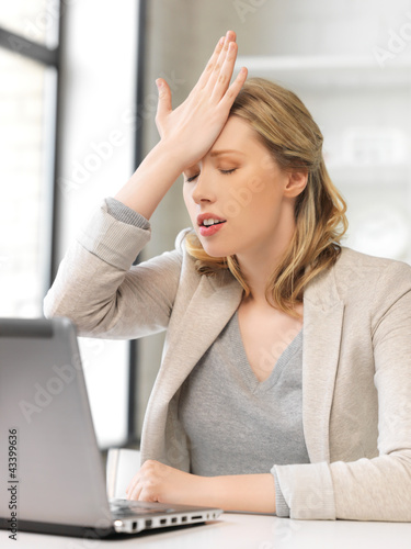 stressed woman with laptop computer