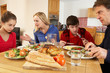 Family Having Argument Whilst Eating Lunch Together In Kitchen