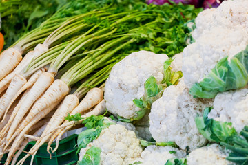 Cauliflower and other vegetables on a counter in the market