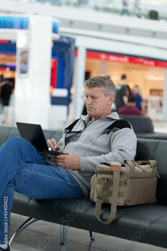 mature man in a waiting room of the modern international airport