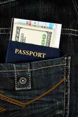 passport with boarding pass and money in jeans