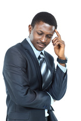 Young business man holding his head in pain