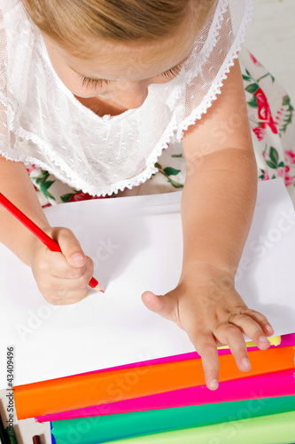 beautiful  little girl  drawing with pencil