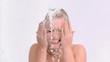 Happy woman in slow motion splashing her face
