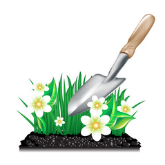grass with ground and garden trowel