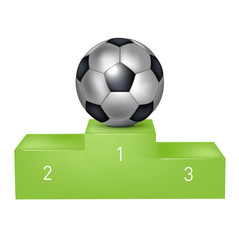 soccer ball on green pedestal