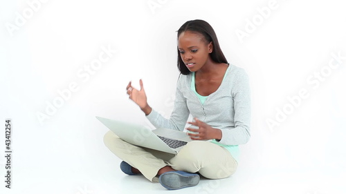 Angry woman typing on a computer