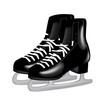pair of black ice skates on white