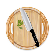 wooden board with knife and parsley