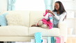 Woman sitting on a couch and looking clothes