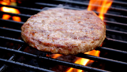 Beef Burger Cooking On The Barbecue
