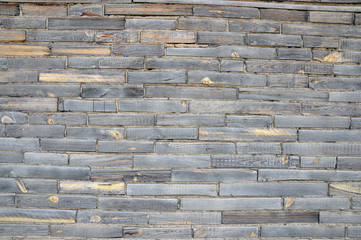 A wall of wooden bricks.