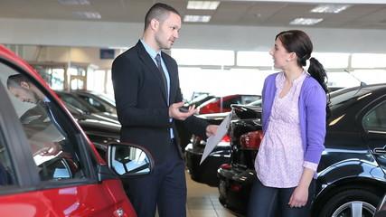 Businessman showing a car