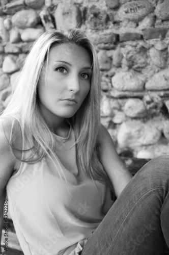 young woman sitting B&W image