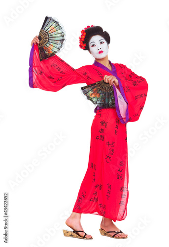 Full length portrait of geisha dancing with fans isolated on whi