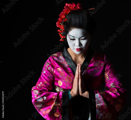 Portrait of geisha with hands together respect gesture isolated