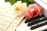 background of piano keyboard with roses