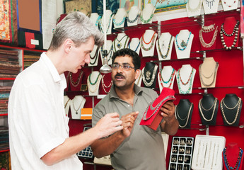 European tourist trades and buys jewelry store in India