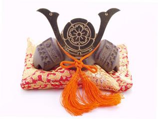 Japanese souvenir. Miniature of a samurai helmet on a pillow.