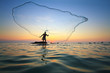 Throwing Fishing Net During Su...