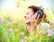 Leinwanddruck Bild - Beautiful Young Woman with Headphones Outdoors. Enjoying Music