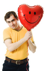 man holding a red heart shaped balloon