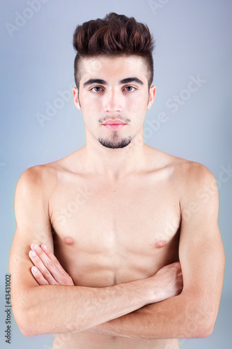 Handsome young man portrait on grey background