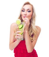 Young woman drinking lemonade, studio-shot