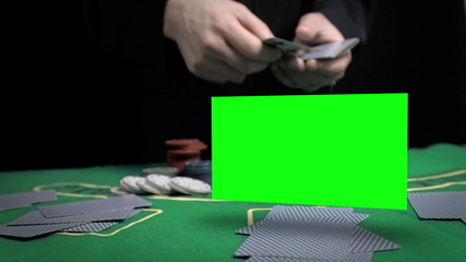 Man throwing cards on the table