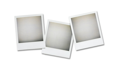 three blank polaroid pictures overhead isolated on white with cl