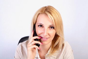 young blonde girl on the phone