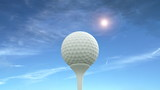 Golf ball against a blue sky is hit into the air.