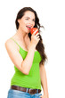 Happy beautiful woman biting an apple