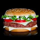 Big hamburger isolated on black backgound with reflection