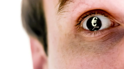 Man with euro symbol in his eye in slow motion