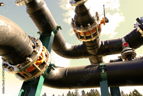 Equipment, cables and piping as found inside of  industrial powe