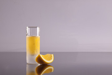 Shot of schnapps with slice of lemon