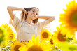 fun woman in the field of sunflower