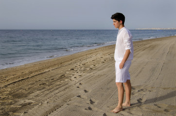 Young man walking on the beach