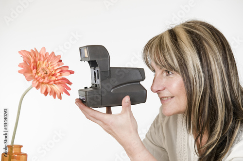 woman photograph orange flower