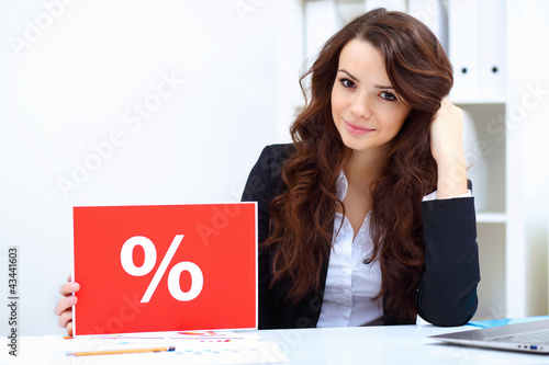 Young business woman with sale sign