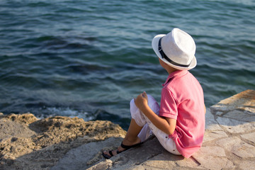 Little boy looks at the sea